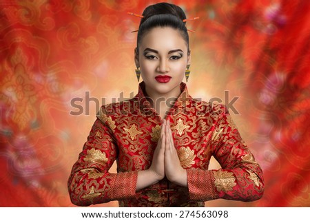Young beautiful girl, lady, woman, model, Asian. Bright makeup, expressive eyes, arrows, bright red lips. Japan, China, tradition,customs, culture . Image can be used for advertising eastern cuisine - stock photo
