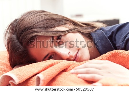 Young beautiful girl lying on her bed