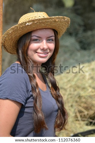 Young Beautiful Girl near a haystack - stock photo