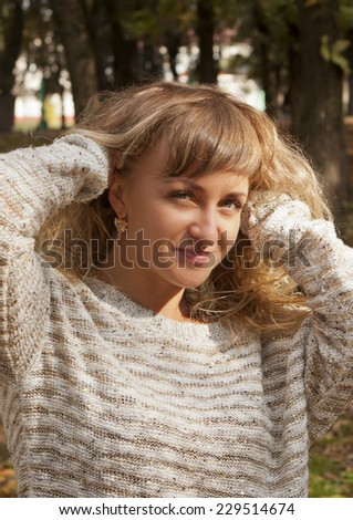 Young beautiful girl on a background in nature. - stock photo