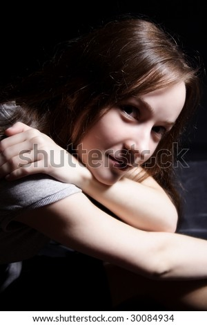 young beautiful girl on a black background
