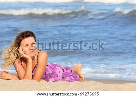 young beautiful girl on the shore of the sea