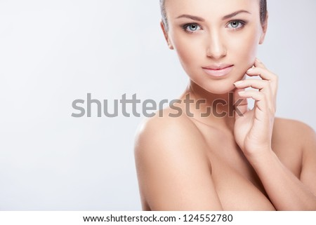 Young beautiful girl on white background - stock photo