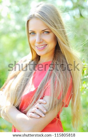 Young beautiful girl outdoors with hands folded - stock photo