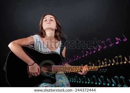 young beautiful girl playing guitar - stock photo