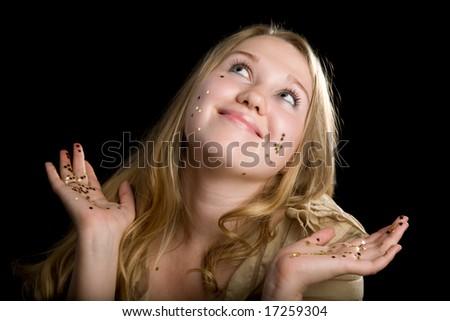 Young beautiful girl  portrait on black - stock photo