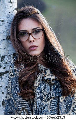 young beautiful girl portrait with eyeglasses and scarf outdoor closeup