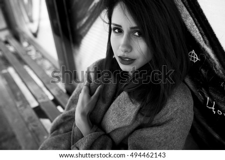 young beautiful girl posing at the camera on the street, close angle