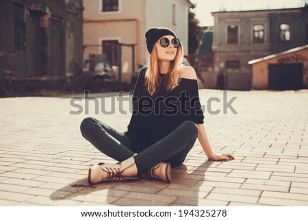 Young beautiful girl posing in the city  - stock photo