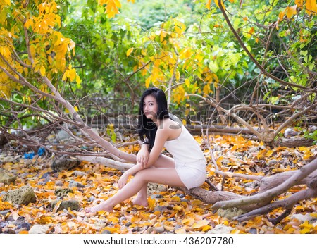 Young beautiful girl relaxing and enjoying peace on vacation. - stock photo