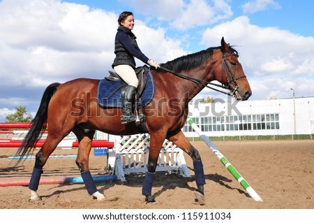 Young beautiful girl riding a running horse - stock photo