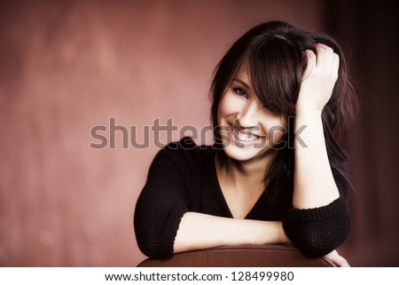 Young beautiful girl smiling cheerfully at you.