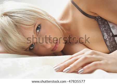 Young beautiful girl temptation in bed