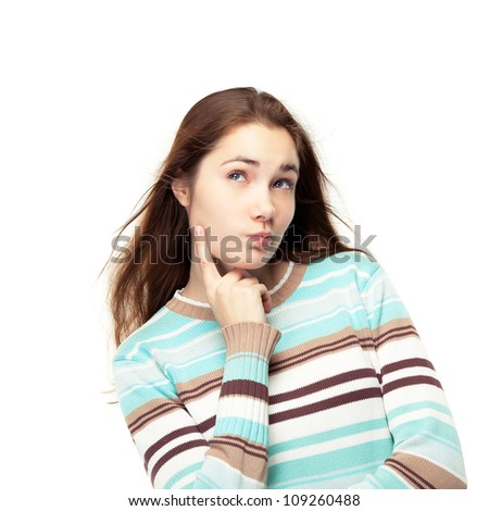 Young beautiful girl thinking / making choice, isolated on white - stock photo