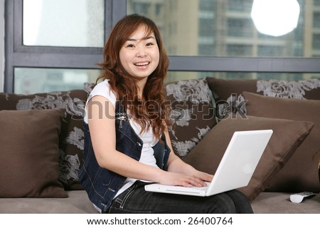 young beautiful girl use pc at home