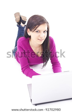 young, beautiful girl using a laptop, isolated background