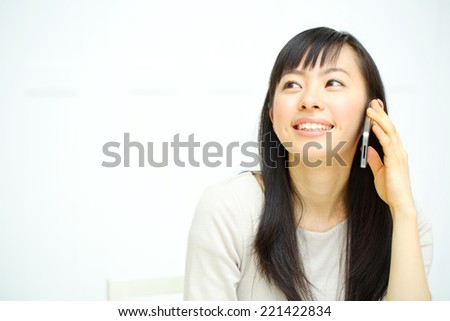 young beautiful girl using mobile phone