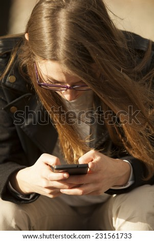 Young Beautiful Girl Using Mobile Phone Outdoor
