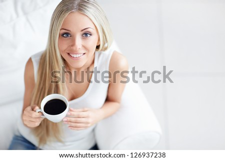 Young beautiful girl with a cup