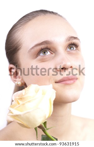 young beautiful girl with a flower isolated on a white background - stock photo