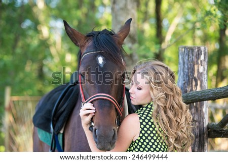 Young beautiful girl with a horse on nature