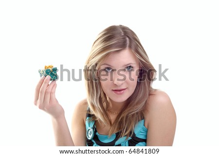 young beautiful girl with a little gift in her hand - stock photo