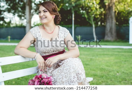 Young beautiful girl with a nice smile in the park.