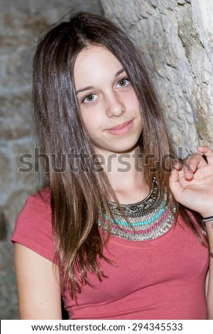 Young beautiful girl with brown hair outdoor portrait
