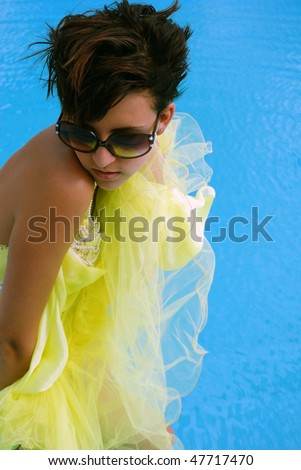 young beautiful girl with fashion drees in pool