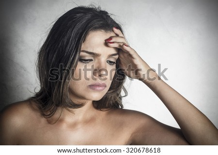 Young beautiful girl with headache