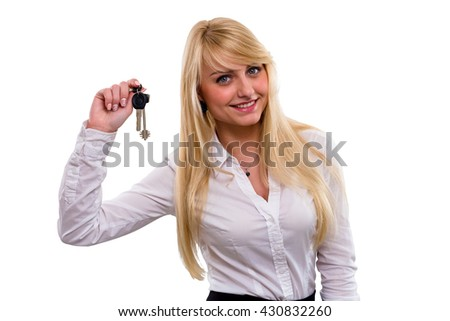 Young beautiful girl with long hair smiles and shows keys isolated over white background
