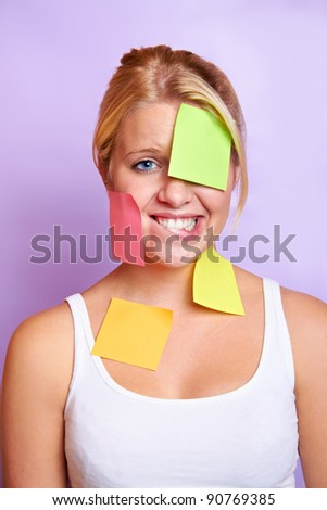 young beautiful girl with notepad on her face - stock photo