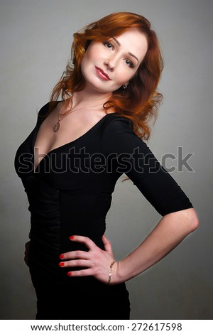 Young beautiful girl with red hair.Isolated studio portrait - stock photo