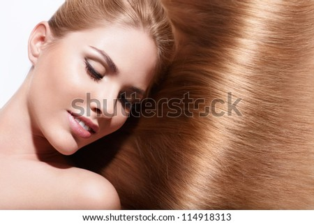 Young beautiful girl with shiny hair
