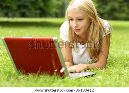 Young beautiful girl with the notebook