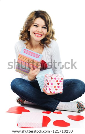 Young beautiful girl with Valentine present boxes
