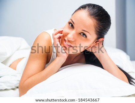 young beautiful girl woke up at home in white bed