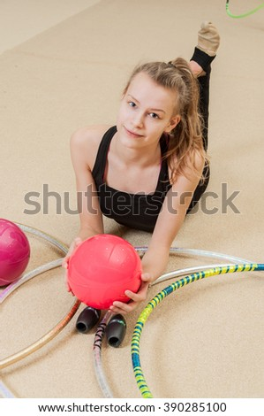 Young beautiful gymnast relax in gym - stock photo