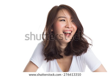 Young beautiful happy asian woman laughing on white background - stock photo