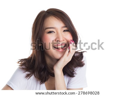 Young beautiful happy asian woman laughing on white background