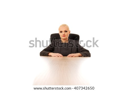 Young beautiful happy businesswoman behind the desk - stock photo