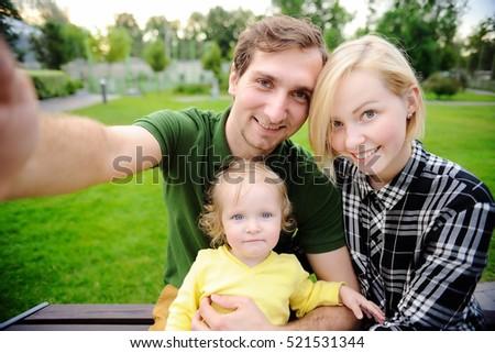 Young beautiful happy family making selfie photo together