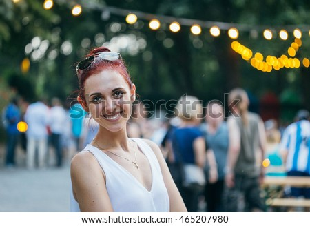 Young Beautiful Happy Girl in Berlin, Evening Time, Bokeh Background