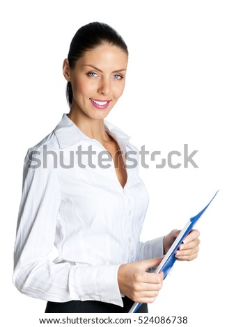Young beautiful happy smiling businesswoman with blue folder, isolated on white background. Caucasian brunette female model in business success concept studio shot.