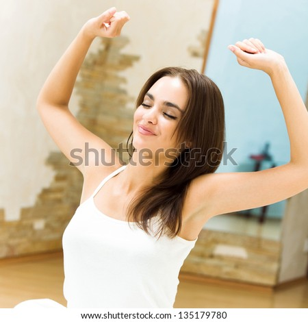 Young beautiful happy smiling woman waking up on bed