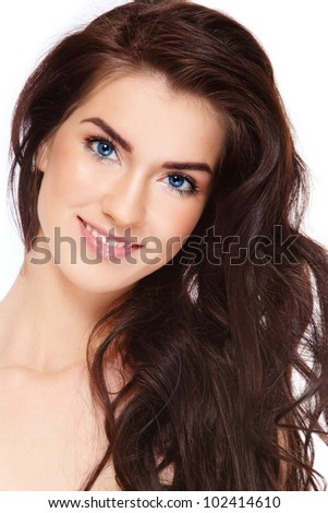 Young beautiful happy smiling woman with long dark hair - stock photo