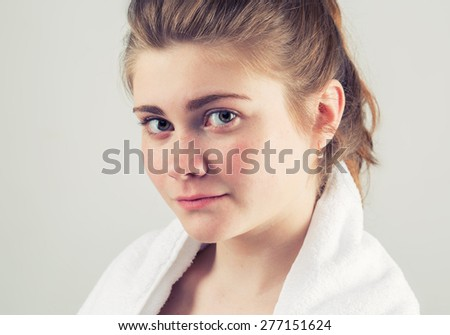 Young beautiful happy woman face portrait with healthy skin - stock photo
