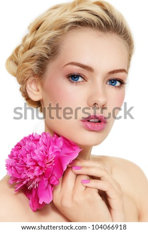 Young beautiful healthy blond girl with pink flower on white background - stock photo