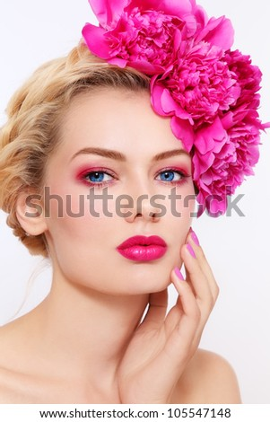Young beautiful healthy blond girl with pink flowers in her hair - stock photo