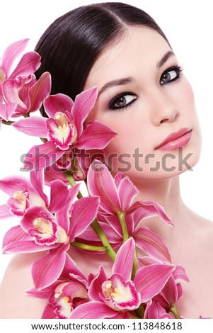 Young beautiful healthy girl with pink orchid on white background - stock photo